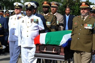 the coffin of South African former president Nelson Mandela being taken on December 14, 2013 to his former home in Qunu.