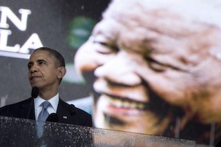 Obama with mandela's  looming image