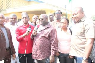 Otelemaba Dan Amachree Speaker Rivers Assembly holding microphone for him is Layii Kwanee his deputy
