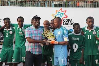 Tolu Oshinubi of FCMB presents trophy to captain of Super sand Eagles