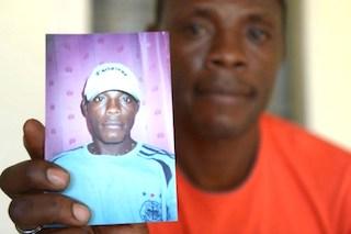 Ferdinand Bengondo, shows the photo of Salomon Bengondo: sad story of neglect
