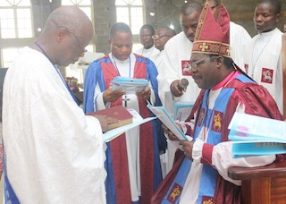 Akeremale with the officiating ministers at the church ceremony