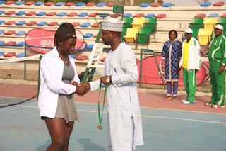 Elizabeth Pam winner girls under 16, receiving her medal from Alkasim Abdulkadir