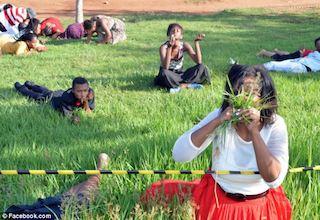 Rabboni Centre members eating grass