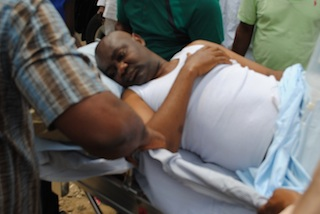 Senator Magnus Abe being stretchered into an ambulance on Sunday