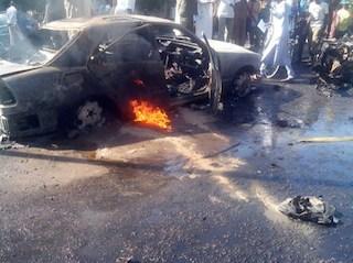 File Photo: A burning car at Maiduguri market after a bomb blast.