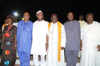 More men and woman  join the trio in a photo-op:    From right, Omisore, Omoworare, , Arch Bishop of Ibadan, Catholic Arch Diocese, Rev. Gabriel Leke Abegunrin;Aregbesola, Special Adviser to the Governor on Sports  Biyi Odunlade , Olabisi, Omoworare's wife