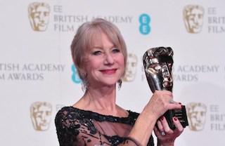 British actress Helen Mirren poses with the academy fellowship award at the BAFTA