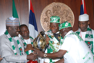 Jonathan being decorated  by sports minister, Bolaji Abdullahi and Dr. Ladipo