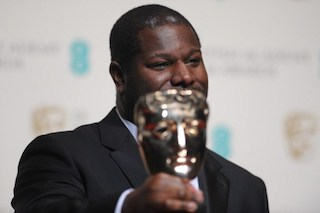 """British director Steve McQueen poses with the award for best film for """"12 Years A Slave"""" at the BAFTA British Academy Film Awards"""
