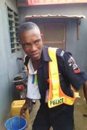 The battered police officer, Corporal Onofe Emmanuel