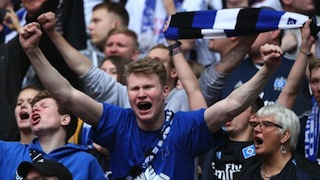Fans of Hamburg celebrate after their club avoid German Bundesliga relegation