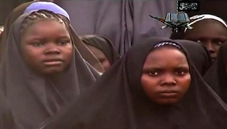 Kidnapped girls are staring into the video. AFP