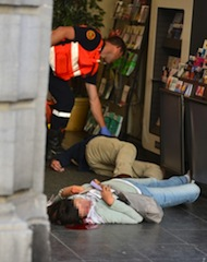 An emergency response worker checks the bodies of two victims of a shooting at a Jewish Museum in Brussels, on May 24, 2014