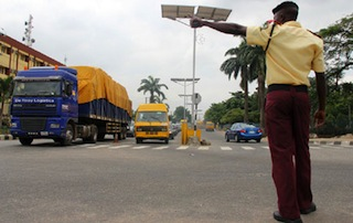 A LASTMA officer conducts the traffic flow in Lagos