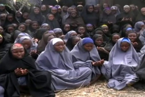 FILE PHOTO: Kidnapped Chibok schoolgirls wearing the full-length hijab and praying in an undisclosed rural location