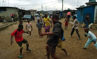 Children playing football on the street