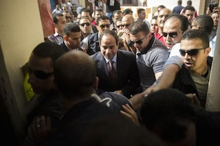 General Sisi arrives to cast his ballot