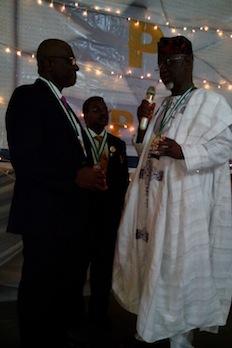 Bayo Onanuga receiving his award from Engr. Bosun Oke today