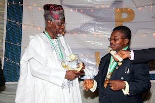 Engr. Bosun Oke (Left) receiving an award from The Chairman  Ijebu Professional Excellence Foundation (IPEF) Chief Olusegun Osideko
