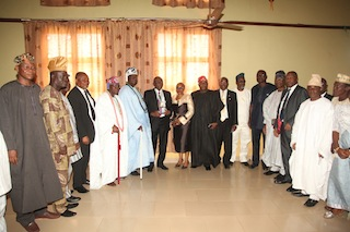 Mr Bayo Onanuga with his wife (Middle) and other well wishers in a group photograph after receiving his award