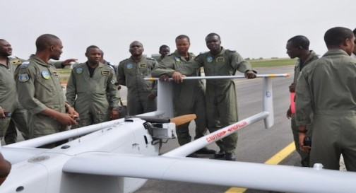 Nigeria's Air Force personnel pose next to a Aerostar drone