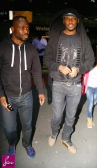 Tu Face Idibia, right, on arrival in London 2 May. Sync Photo