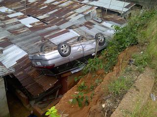 car lands on rooftop