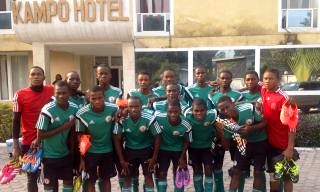 Golden Eaglets pose in front of their hotel camp in Kinshasha