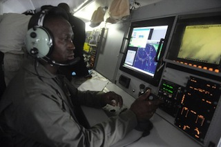 A Nigerian Airforce pilots sit to monitor vessels from ATR 42-500 Maritime Patrol Aircraft acquired to fight maritime crime