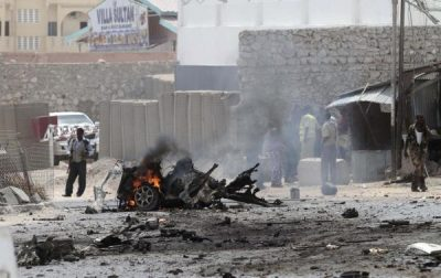 Security personnel gather at the scene of an explosion near the entrance of the airport in Somalia's capital Mogadishu