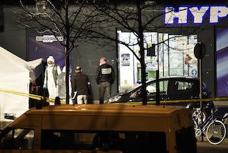 French police officers and forensic experts investigate the scene at the Hyper Casher kosher grocery store near Porte de Vincennes
