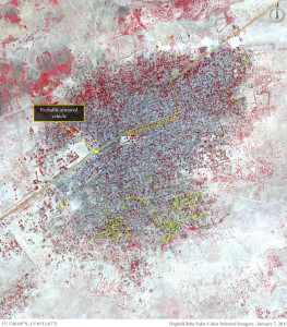 This image show over 620 structures damaged or destroyed predominantly located in the southern portion of Baga, Borno State, Nigeria. Vehicle activity is present along the main road, including a probably armoured vehicle stationed at a road block close to the centre of town