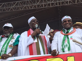 Chief Tony Anenih (C) flanked by Tom Ikimi (L) and Dan Orbih (R) addresses supporters of PDP