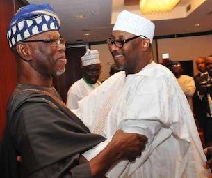 L-R: Chief John Oyegun, national chairman of the APC and Alhaji Adamu Mu'azu, national chairman of the PDP in warm embrace