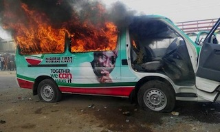 Gutted: Jonathan's campaign bus is set ablaze by unidentified youths