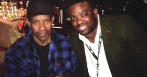 •Afolayan with Denzel Washington in America