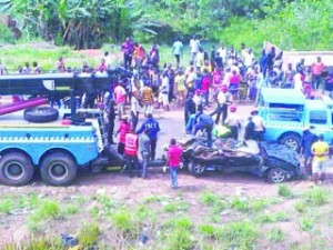 •Federal Road Safety officials at the scene where an SUV crashed on Benin expressway on Monday