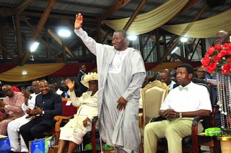 President Jonathan acknowledges the cheers of the crowd