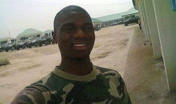 Jovial Uchenna takes a selfie in a camouflage shirt