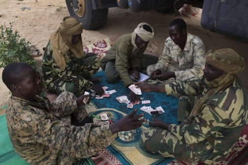 Chadian soldiers play cards in Damasak after liberating the town