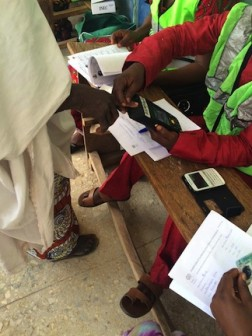 INEC official registering a voter