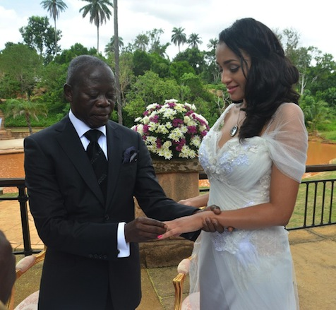 Governor Adams Oshiomhole slips a ring on a finger of Miss Iara Fortes at a private marriage registry at Iyamho, Etsako West Local Government Area of Edo State, on Friday