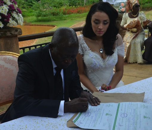 Governor Adams Oshiomhole signs the dotted lines at the registry