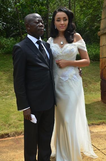 Model, Iara Fortes teaches Adams Oshiomhole how to strike a pose