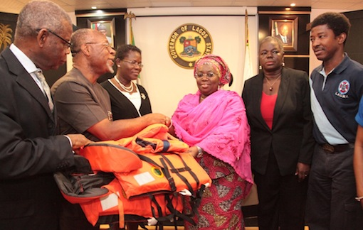 Lagos State Deputy Governor, Dr. (Mrs.) Oluranti Adebule (3rd right) receiving some life Jackets from  the Deputy Managing Director, Total Exploration & Production Nigeria Limited, Mr. Charles Ngoka (2nd left) during the Official handing over of 2,400 Life Jackets donated by Total Nigeria PLC. to the Lagos State Government  at the Lagos House, Ikeja, on Wednesday, July 29, 2015. With them are: Managing Director, Lagos State Waterways Authority (LASWA), Mr. Olayinka Marinho (right), Acting Permanent Secretary, Ministry of Transportation, Mrs. Adebisi Ariyo (2nd right), Supervisory Community Development National Petroleum Investment Management Services, Mrs. Helen Nkwo (3rd left) and Business Development Manager, Emo Exploration & Production Limited, Mr. Dennis Otsemobior (left).
