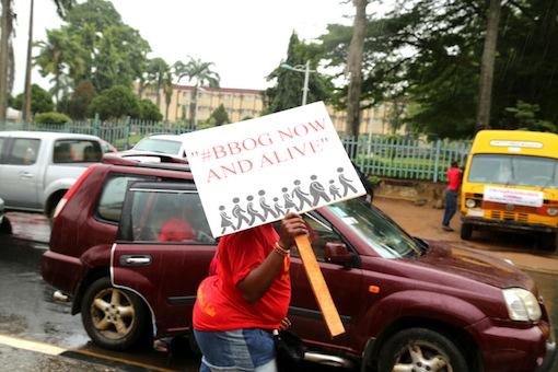 A girl with a banner asking for release of Chibok girls. Photo Idowu Ogunleye