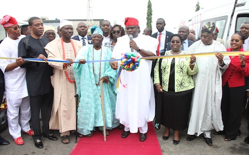 Lagos State Governor, Mr. Akinwunmi Ambode (4th right) cutting the tape to commission the 20 Mobile Care Unit and 26 Number Transport Ambulances at Lagos House, Ikeja, on Monday, August 31, 2015. With him are Deputy Governor, Dr. (Mrs.) Oluranti Adebule (3rd right), State Chairman, All Progressives Congress (APC), Otunba Henry Ajomale (2nd right), Head of Service, Mrs. Folasade Jaji (right), the Alara of IIlara-Epe, Oba Hakeem Adesanya (4th left), the Opeluwa of Lagos, chief Lateef Ajose (3rd left), Senator Ganiyu Solomon (2nd right) and the Deputy Speaker, Lagos State House of Assembly, Hon. Wasiu Eshinlokun  Sanni (left)