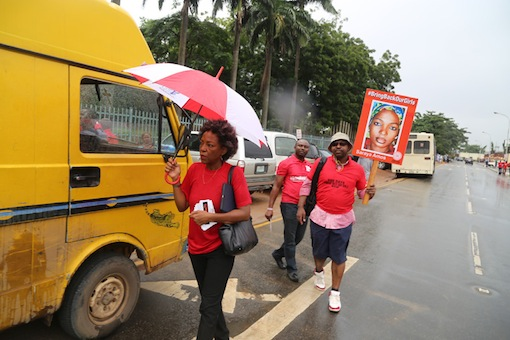 Ayo Obe (L) with an activist at the rally. Photo Idowu Ogunleye