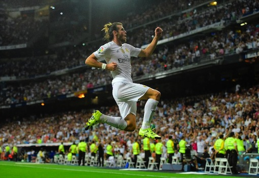 Real Madrid's Welsh forward Gareth Bale celebrates after scoring his second goal during the Spanish league football match Real Madrid CF vs Real Betis Balompie at the Santiago Bernabeu stadium in Madrid on August 29, 2015 (AFP Photo/Pierre-Philippe Marcou)
